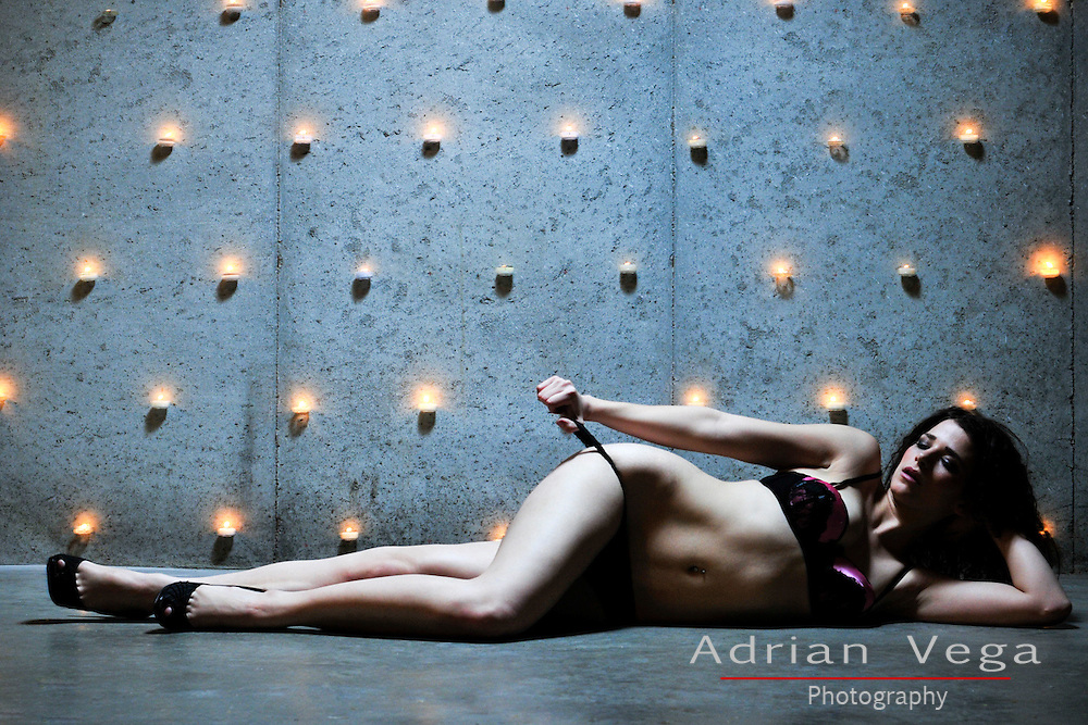 Suggestive image in lingerie, with a candle wall, mixing nature's elements with femininity