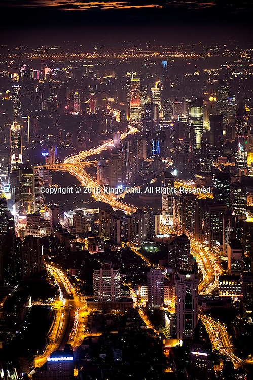 The Shanghai skyline with freeways are viewed from the Shanghai Tower in Shanghai, China. Shanghai is the most populous city in China and the most populous city proper in the world. It is one of the four direct-controlled municipalities of China, with a population of more than 24 million as of 2014. It is a global financial centre, and a transport hub with the world's busiest container port. Located in the Yangtze River Delta in East China, Shanghai sits on the south edge of the mouth of the Yangtze in the middle portion of the Chinese coast. The municipality borders the provinces of Jiangsu and Zhejiang to the north, south and west, and is bounded to the east by the East China Sea. A major administrative, shipping, and trading town, Shanghai grew in importance in the 19th century due to trade and recognition of its favourable port location and economic potential. The city was one of five forced open to foreign trade following the British victory over China in the First Opium War while the subsequent 1842 Treaty of Nanking and 1844 Treaty of Whampoa allowed the establishment of the Shanghai International Settlement and the French Concession. The city then flourished as a center of commerce between China and other parts of the world (predominantly Western countries), and became the primary financial hub of the Asia-Pacific region in the 1930s. However, with the Communist Party takeover of the mainland in 1949, trade was limited to socialist countries, and the city's global influence declined. In the 1990s, the economic reforms introduced by Deng Xiaoping resulted in an intense re-development of the city, aiding the return of finance and foreign investment to the city. Shanghai has been described as the &quot;showpiece&quot; of the booming economy of mainland China; renowned for its Lujiazui skyline, museums and historic buildings, such as those along The Bund, the City God Temple and the Yu Garden.(Photo by Ringo Chiu/PHOTOFORMULA.com)<br /> <br /> Usage Notes: This content is intended fo