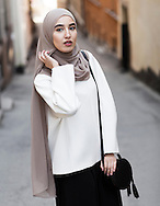 Hijabistas. Imane Asry, 25 years, born in Marocko living in Stockholm. Youtuber abd Instagram profile @fashionwithfaith with 121000 followers.<br /> <br /> &quot;I have alsways loved fashion, ever since I was a little girl. I was always the one who dressed a bit odd without caring what other's thouhgt. My followers on Instagram appreciates that I'm different within the hijab fashion field, with my minimalist and monocrome style. I like the sober and  classic look. Hijab fashion is a lot about crazy colors.&quot;