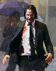 "Keanu Reeves gets soaking wet while sporting bloody wounds as he shot intense running scenes in the rain for the highly anticipated ""John Wick Chapter 3"" filming in the wee hours of Tuesday morning as he shot for 10 hours drenched from the pouring rain in Downtown Manhattan. 08 May 2018 Pictured: Keanu Reeves. Photo credit: LRNYC / MEGA TheMegaAgency.com +1 888 505 6342"
