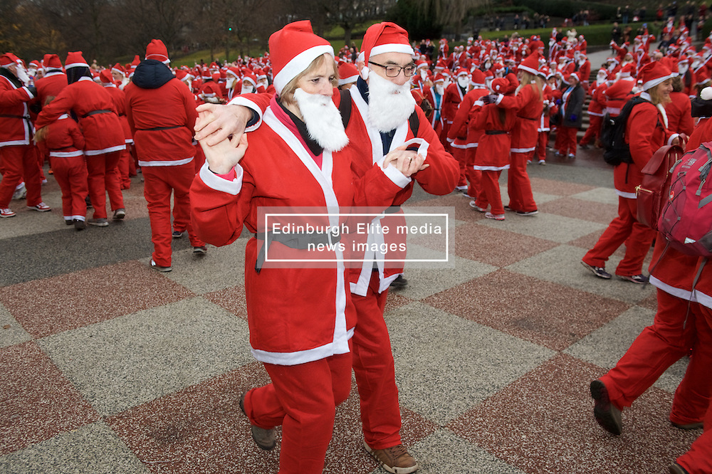 Over 1600 Santas complete a Gay Gordon warm up dance before Santa's takeing part in Scotland's fundraising Santa's run, walk and stroll around Edinburgh's West Prices Street Gardens, raising money to grant the Wishes of Children for When You Wish Upon A Star. Sunday 11th December 2016. (c) Brian Anderson | Edinburgh Elite media