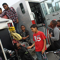 EMILY TUBB/ BUY AT PHOTOS.MONROECOUNTYJOURNAL.COM<br /> From left, Isaiah Spratt, Bishop Parks, Travarious Buckner, Jaylen Blanchard, Kylon Love, Kabreun Love and Traylon Bailey kill time while waiting for the Dr. Martin Luther King, Jr. Day motorcade to begin Jan. 15 by playing on an Amory fire truck.