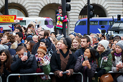 © Licensed to London News Pictures. 01/01/2017. London, UK. People watch London's New Year's Day Parade, the event is one of the world's great street spectaculars with up to 10,000 performers from around the world and hosts marching bands, cheerleaders, leading companies, unions and local boroughs celebrating the arrival of 2017. Photo credit: Tolga Akmen/LNP
