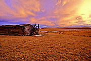 Old Homestead at sunset. Rocky Mountain Front west of Augusta, Montana