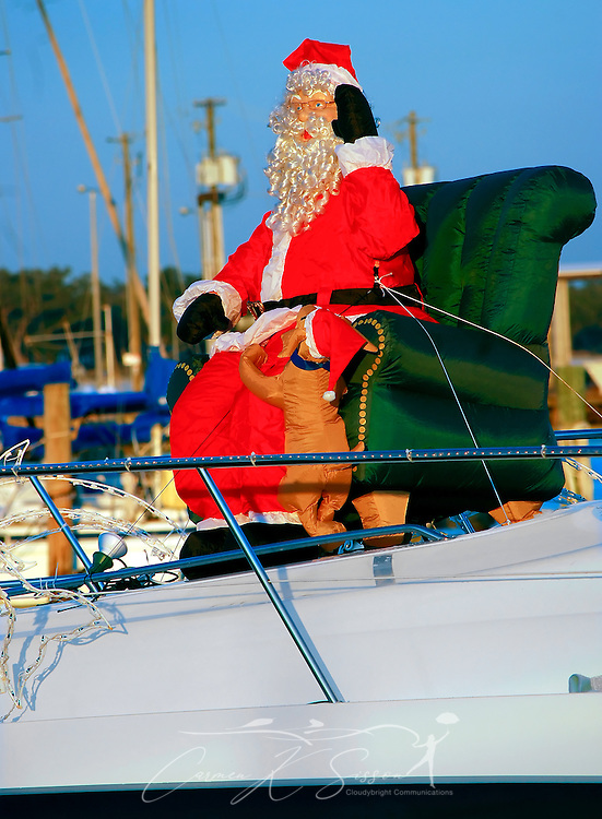 "A mechanical Santa greets visitors at the Pass Christian Yacht Club in Pass Christian, Mississippi on Dec. 8, 2010. The Christmas scene is part of holiday decorations aboard the yacht, ""High Maintenance."" (Photo by Carmen K. Sisson/Cloudybright)"