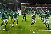 Hibs players warm up for the Ladbrokes Scottish Premiership match between Hibernian and Rangers at Easter Road, Edinburgh, Scotland on 8 March 2019.