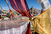 Prayer flags at the base of Amnye Amchen mountain in Amdo region, Tibet (Qinghai, China).