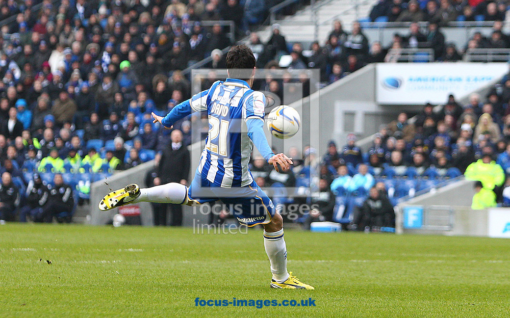 Picture by Paul Terry/Focus Images Ltd +44 7545 642257.23/02/2013.David Lopez of Brighton and Hove Albion scores the opening goal during the npower Championship match at the American Express Community Stadium, Brighton and Hove.