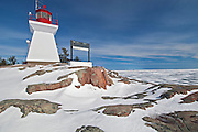 Killarney East Lighthouse on Red Rock Point of  Georgian Bay (Lake Huron). Killarney East Lighthouse on Red Rock Point of  Georgian Bay (Lake Huron). Precambrian shield in winter<br /> Killarney<br /> Ontario<br /> Canada