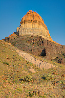 Cerro Castellan - also known as Castolon Peak or Castellan Peak, is a conical volcanic mountain in West Texas that rises 1000 feet above the desert floor (3,293 feet above sea level) in Big Bend National Park. Cerro Castellan itself is part of an ancient series of summits once known as the Corazones Peaks that has since succumbed to millennia of erosion by wind, precipitation, searing heat and bitterly cold winters. <br />