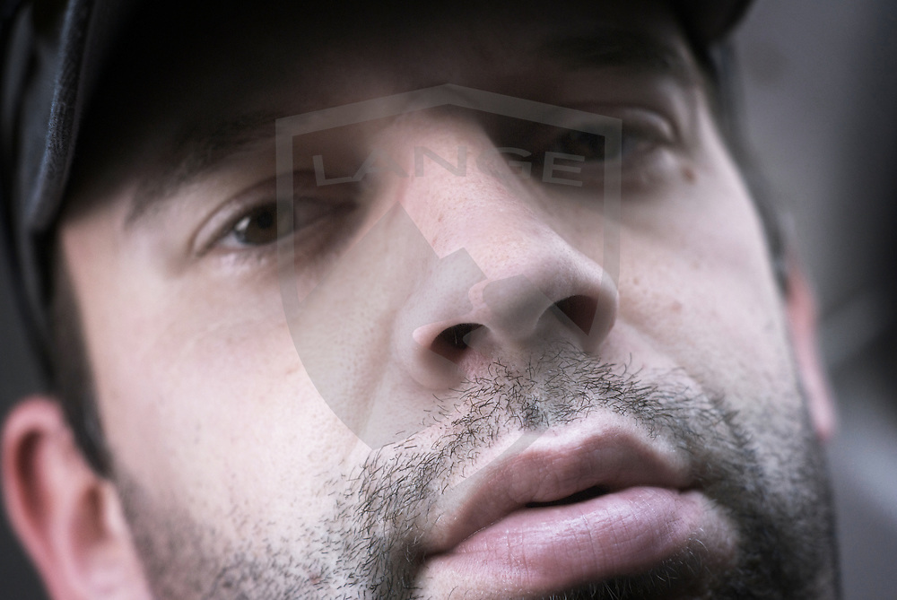 adult man portrait looking into camera with serious look close up horizontal composition