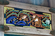 """A new couple embarks on life together, facing a tidal wave of trials and tribulations,"" in one of 8 panels of art work on a storehouse in Toshogu shrine in Nikko, Japan. Hidari Jingoro may have carved these panels to incorporate Confucius's Code of Conduct, using the monkey as a way to depict man's life cycle. The monkeys are Japanese macaques, a common species in Japan. Toshogu Shrine is the final resting place of Tokugawa Ieyasu, the founder of the Tokugawa Shogunate that ruled Japan for over 250 years until 1868. Ieyasu is enshrined at Toshogu as the deity Tosho Daigongen, ""Great Deity of the East Shining Light"". Initially a relatively simple mausoleum, Toshogu was enlarged into the spectacular complex seen today by Ieyasu's grandson Iemitsu during the first half of the 1600s. The lavishly decorated shrine complex consists of more than a dozen buildings set in a beautiful forest. Toshogu contains both Shinto and Buddhist elements, as was common until the Meiji Period when Shinto was deliberately separated from Buddhism. Toshogu is part of Shrines and Temples of Nikko UNESCO World Heritage site."