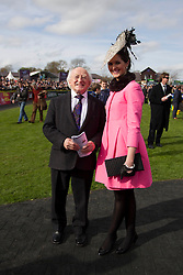 Repro Free: 23/04/2013 President Michael D. Higgins is pictured congratulating Eimear Nash from Stepaside Co. Dublin the winner of the Coast Best Dressed Lady on the opening day of the Punchestown Raceing Festival. Pic Andres Poveda