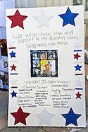 AUG. 12, 2012 - OCEANSIDE, NEW YORK U.S. - Poster expressing support from Oceanside High School Junior Varsity Cheerleaders to family of Lance Corporal Greg Buckley, Jr, the 21-year-old Marine from Long Island killed in Afghanistan 3 days earlier.
