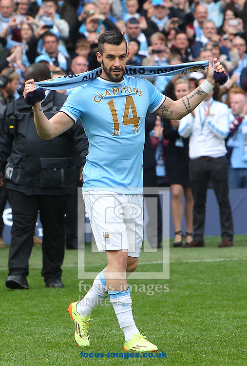 Alvaro Negredo of Manchester City celebrates winning the Barclays Premier League at the Etihad Stadium, Manchester<br /> Picture by John Rainford/Focus Images Ltd +44 7506 538356<br /> 11/05/2014
