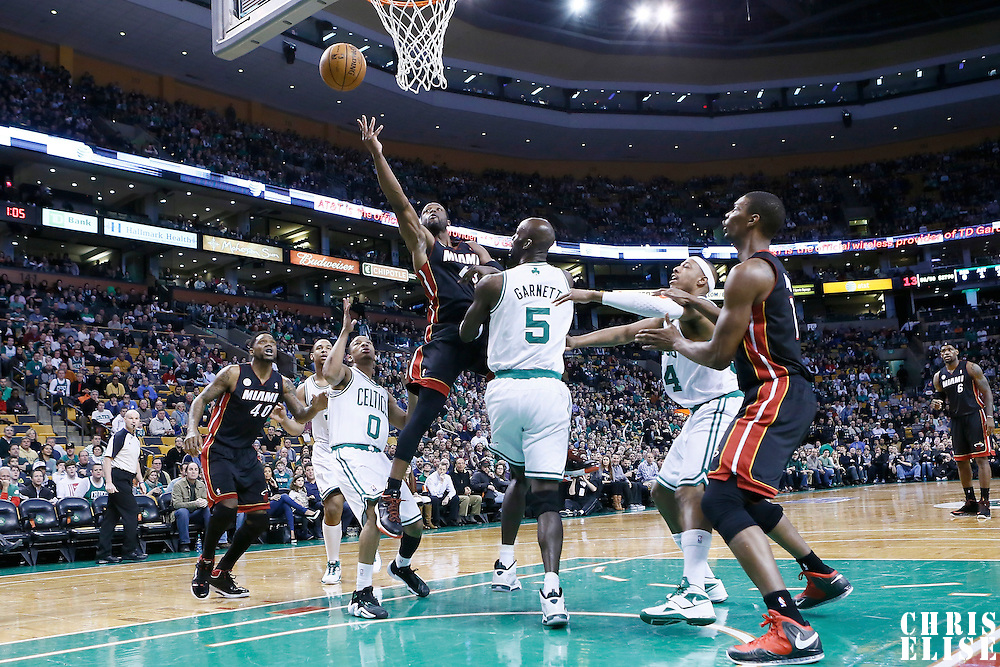 27 January 2013: Miami Heat shooting guard Dwyane Wade (3) goes for the layup against Boston Celtics power forward Kevin Garnett (5) during the Boston Celtics 100-98  2OT victory over the Miami Heat at the TD Garden, Boston, Massachusetts, USA.