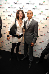Actress NEVE CAMPBELL and LEWIS HAMILTON at the TAG Heuer British Formula 1 Party at the Mall Galleries, London on 15th September 2008.