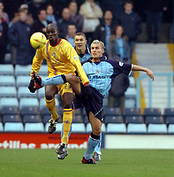Picture: Henry Browne.<br />Date: 22/11/2003.<br />Coventry City v Gillingham Nationwide Division One.<br /><br />Gillingham's Mamady Sidibe holds off Coventry's Craig Pead