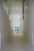 Photo shows the corridor leading up to the museum shop and cafe at the Aomori Museum of Art in Aomori City, Aomori Prefecture, Japan on 11 July, 2001. The building was designed by Jun Aoki, the inspiration coming from the nearby Sannai Maruyama archeological site. .Photographer: Robert Gilhooly