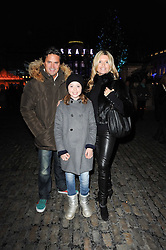 TINA HOBLEY and OLIVER WHEELER with their daughter ISABELLA at Skate presented by Tiffany & Co at Somerset House, London on 22nd November 2010.