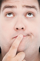 Overweight Man with Finger on Mouth portrait close up