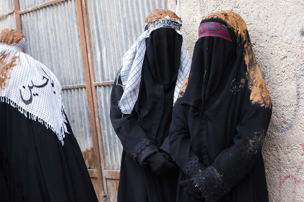 Mourning Shi'a muslim women, covered with mud, during the Day of Ashura, on which shi'a muslims commemorate the martyrdom of Husayn ibn Ali, grandson of Muhammad, and third shi'a imam (Bijar, Iran, 2012).