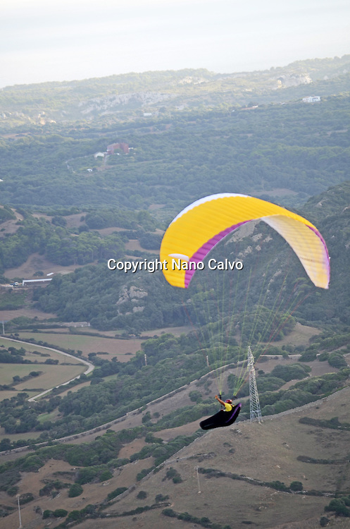People practicing paragliding from Mount Toro (Monte Toro), Menorca