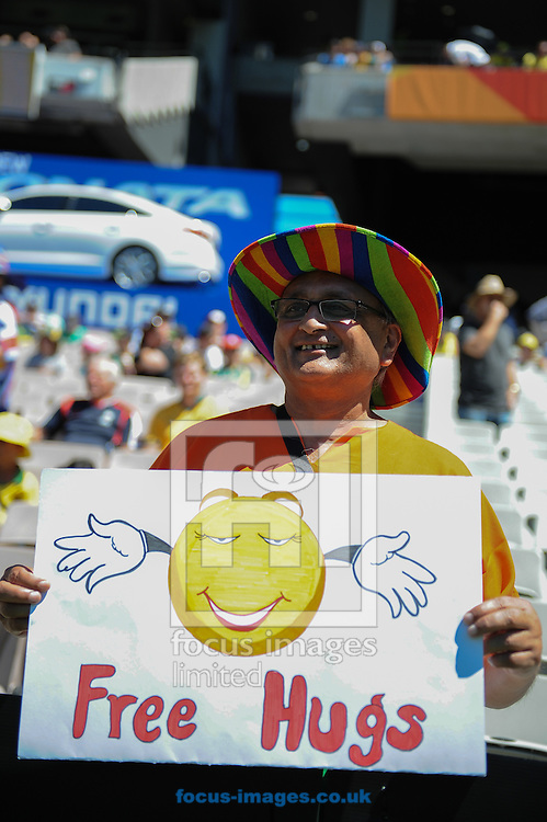 A fan holding a sign during the 2015 ICC Cricket World Cup match at Melbourne Cricket Ground, Melbourne<br /> Picture by Frank Khamees/Focus Images Ltd +61 431 119 134<br /> 14/02/2015