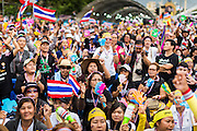 "15 NOVEMBER 2013 - BANGKOK, THAILAND:  Tens of thousands of Thais packed the area around Democracy Monument in the old part of Bangkok Friday night to protest against efforts by the ruling Pheu Thai party to pass an amnesty bill that could lead to the return of former Prime Minister Thaksin Shinawatra. Protest leader and former Deputy Prime Minister Suthep Thaugsuban announced an all-out drive to eradicate the ""Thaksin regime."" The protest Friday was the biggest since the amnesty bill issue percolated back into the public consciousness. The anti-government protesters have vowed to continue their protests even though the Thai Senate voted down the bill, thus killing it for at least six months.     PHOTO BY JACK KURTZ"