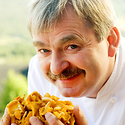 Head chef holding fresh chanterelle mushrooms