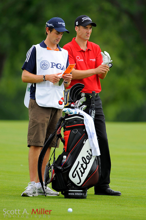 Aug 13, 2009; Chaska, MN, USA; Ross Fisher (GBR) talks with his caddie on the third fairway during the first round of the 2009 PGA Championship at Hazeltine National Golf Club.  ©2009 Scott A. Miller