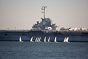 Sailboat race near the USS Yorktown aircraft carrier in Charleston harbor.