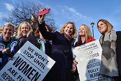 © Licensed to London News Pictures. 06/02/2018. LONDON, UK.  Female members of the Shadow Cabinet and Labour politicians stand outside the Houses of Parliament, wearing Labour styled suffragette rosettes, hold placards next to a '100 Years of Women Voting' banner help launch Labour's campaign to celebrate 100 years of women's suffrage.    Photo credit: Stephen Chung/LNP