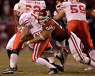 University of Oklahoma defensive end C.J. Ah You (99) sack Nebraska quarterback Zac Taylor (13) in the first half during the Big 12 Championship game at Arrowhead Stadium in Kansas City, Missouri, December 2, 2006.  Oklahoma beat Nebraska 21-7.<br />