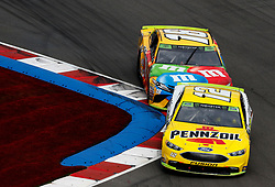 September 30, 2018 - Charlotte, NC, U.S. - CHARLOTTE, NC - SEPTEMBER 30: #18: Kyle Busch, Joe Gibbs Racing, Toyota Camry M&M's #12: Ryan Blaney, Team Penske, Ford Fusion Menards/Pennzoil during the running of the Inagural Bank of America ROVAL 400 on Sunday September 30, 2018 at Charlotte Motor Speedway in Concord North Carolina  (Photo by Jeff Robinson/Icon Sportswire) (Credit Image: © Jeff Robinson/Icon SMI via ZUMA Press)