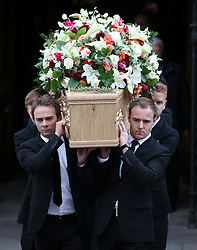 © Licensed to London News Pictures . 18/03/2016 . Manchester , UK . The coffin being carried from the church by actors Jack P. Shepherd and Alan Halsall (both front) following the service. Television stars and members of the public attend the funeral of Coronation Street creator Tony Warren at Manchester Cathedral . Photo credit : Joel Goodman/LNP