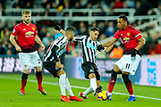 Ayoze Perez (#17) of Newcastle United challenges Anthony Martial (#11) of Manchester United during the Premier League match between Newcastle United and Manchester United at St. James's Park, Newcastle, England on 2 January 2019.