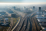 Nederland, Noord-Holland, Amsterdam, 11-12-2013; Amsterdam Sloterdijk, kruising A10 West (Einsteinweg) met A5 (Westrandweg), naar rechts.<br /> De blauwe band in de lucht is het gevolg van inversie (warme luchtlaag boven koude luchtlaag).<br /> Junction of new ringroad Amsterdam. The blue band in the air is a result of inversion (warm air layer above the cold air layer).<br /> luchtfoto (toeslag op standard tarieven);<br /> aerial photo (additional fee required);<br /> copyright foto/photo Siebe Swart