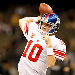 November 28, 2011; New Orleans, LA, USA; New York Giants quarterback Eli Manning (10) warms up prior to kickoff of a game against the New Orleans Saints at the Mercedes-Benz Superdome. Mandatory Credit: Derick E. Hingle-US PRESSWIRE