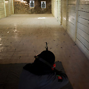 November 14, 2012 - Kabul, Afghanistan: Afghan National Police (ANP) female cadets during shooting exercises at the Afghan Nacional Police Academy shooting range...ANP Academy trains 1250 cadets at the time during a period of four years. Every year, five hundred new recruits are selected, out of more than nine thousand of candidates, to join the academy and other five hundred graduate. Fifteen per cent of the recruits are women. (Paulo Nunes dos Santos/Polaris)