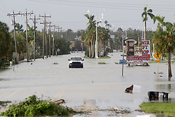 September 11, 2017 - Everglades City, Florida, U.S. - A pickup truck moves through Collier Avenue on Monday in downtown Everglades City, which became flooded with water in the aftermath of Hurricane Irma's landfall on Sunday. (Credit Image: © Douglas R. Clifford/Tampa Bay Times via ZUMA Wire)