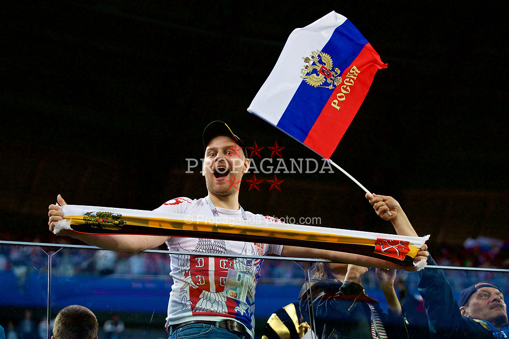 SAINT PETERSBURG, RUSSIA - Tuesday, June 19, 2018: A Russia supporter celebrates as his side beat Egypt 3-1 during the FIFA World Cup Russia 2018 Group A match between Russia and Egypt at the Saint Petersburg Stadium. (Pic by David Rawcliffe/Propaganda)