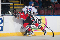 KELOWNA, CANADA - NOVEMBER 29: Madison Bowey #4 of Kelowna Rockets checks Sam Steel #39 of Regina Pats into the boards on November 29, 2014 at Prospera Place in Kelowna, British Columbia, Canada.  (Photo by Marissa Baecker/Shoot the Breeze)  *** Local Caption *** Madison Bowey; Sam Steel;