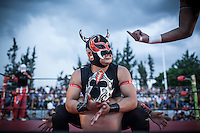 At a lucha libre match in Oaxaca, Mexico, luchadores entertain the audience.