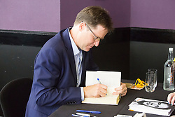 "Brighton, UK. The RT Hon NICK CLEGG MP signs copies of his book ""politics, Between the extremes"" at the Liberal Democrats Autumn Conference. Photo Credit: Hugo Michiels"