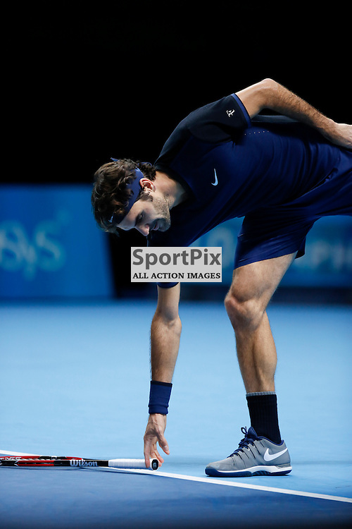 Roger Federer's picks up his racket during a semi-final match between Roger Federer and Stan Wawrinka at the ATP World Tour Finals 2015 at the O2 Arena, London.  on November 21, 2015 in London, England. (Credit: SAM TODD | SportPix.org.uk)