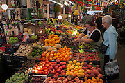 A fruit stall selling citrus and other varieties such as strawberries, avocados, cherries and melon, in Mercado do Bolhao, on 20th July, in Porto, Portugal. The 19th-century, wrought-iron Mercado do Bolhão does a brisk trade in fresh produce, including cheeses, olives, smoked meats, sausages, breads and more. At its lively best on Friday and Saturday mornings, the market is also sprinkled with inexpensive stalls where you can eat fish so fresh it was probably swimming in the Atlantic that morning, or taste or sample local wines and cheeses. (Photo by Richard Baker / In Pictures via Getty Images)