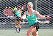 Iowa City West's Brittani Langland reaches out for the ball during the Class 2A state team tennis tournament at Veterans Memorial Tennis Center in Cedar Rapids on Saturday, June 1, 2013.
