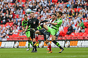 \Forest Green's Aarran Racine and Grimsby Town's Pádraig Amond challenge for the ball during the Conference Premier Final match between Forest Green Rovers and Grimsby Town FC at Wembley Stadium, London, England on 15 May 2016. Photo by Shane Healey.