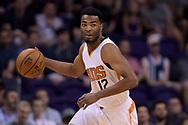 Mar 15, 2017; Phoenix, AZ, USA; Phoenix Suns forward TJ Warren (12) handles the ball against the Sacramento Kings in the first half at Talking Stick Resort Arena. Mandatory Credit: Jennifer Stewart-USA TODAY Sports